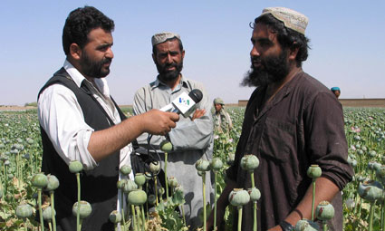 Photo of Reporter Interviewing Afghan Poppy Cultivators