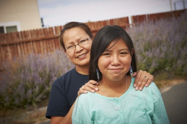 A photo of a Native American woman and her daughter.