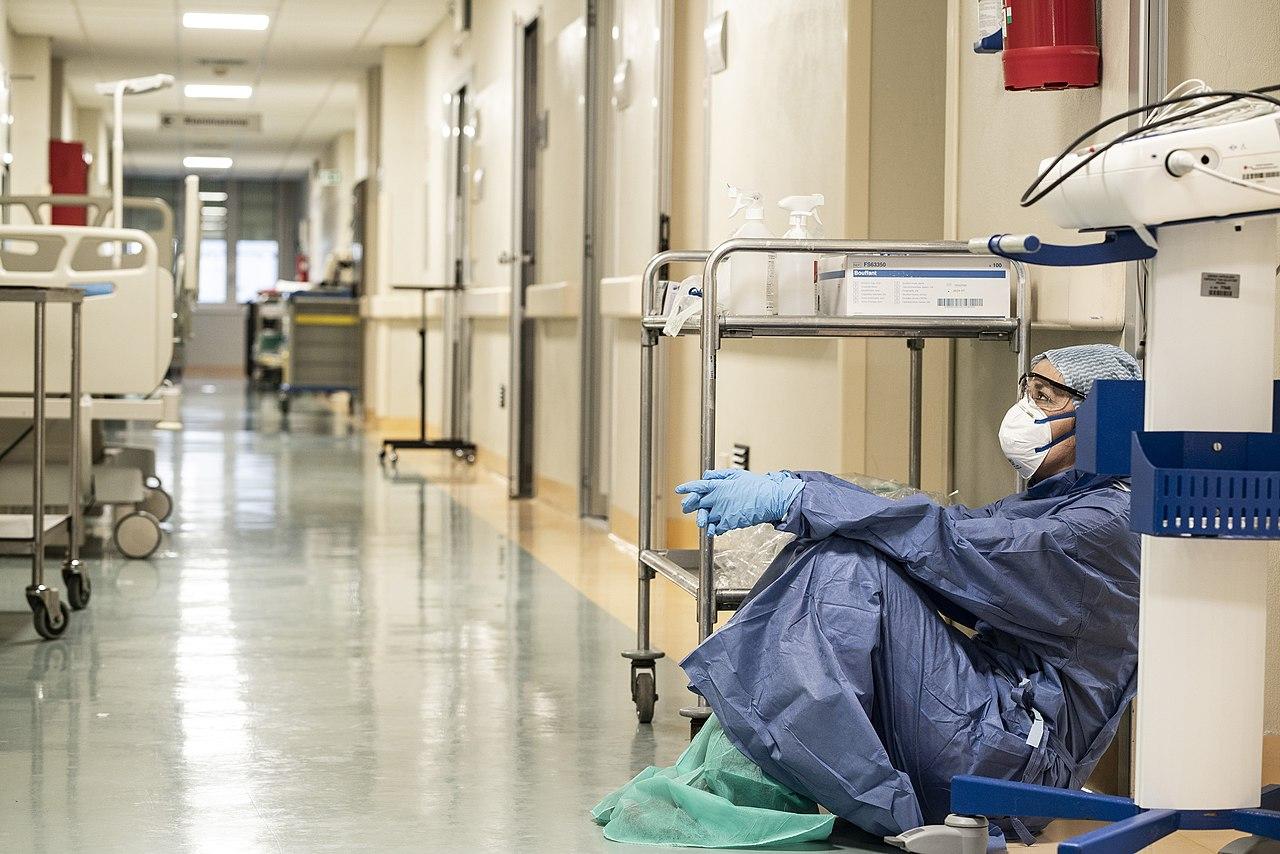 Tried healthcare worker taking a break.