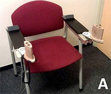A chair with a The BATRAC upper extremity training device attached.