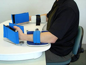 A photograph of a device used for upper  extremity training called the Rocker.