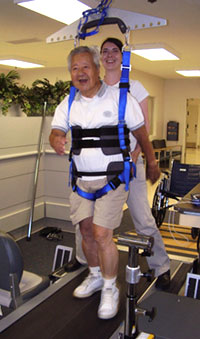 man using a body-weight-assisted treadmill