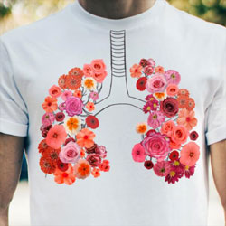T-Shirt showing the lungs as colorful flowers.