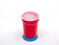A cup with a weighted bottom and a lid.