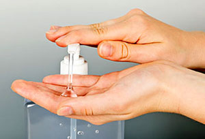 Photo of Person Using Hand Sanitizer