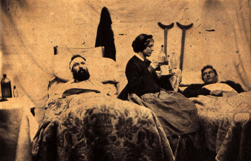 An 1864 photograph of a nurse attending to men wounded in the Batte of Nashville.