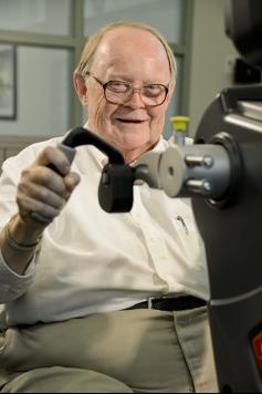 Image: man using upper extremity bike