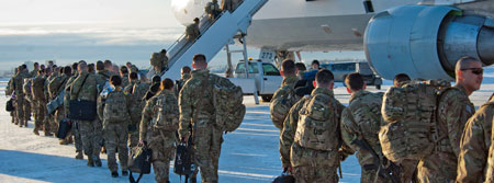 photo of troops boarding a plane