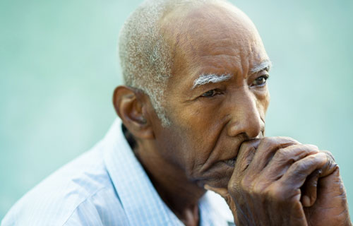 Photo: man depressed about the loss of his spouse
