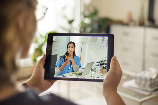 A doctor talking to a patient using telemedicine.
